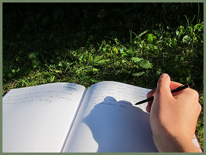Emma Larkins - writing outdoors