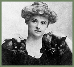 poet Renée Vivien with an upswept hairdo and a cat perched on each shoulder